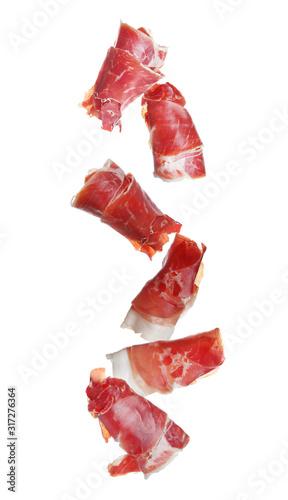 Cuadros en Lienzo Falling delicious sliced jamon on white background