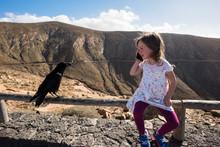Little Girl And Black Raven