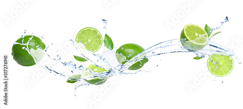 Cuadros en Lienzo Ripe limes, fresh mint and splashing water on white background