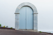 Light Blue Arched Door With St...