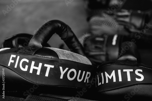 Stampa su Tela Close up of FIGHT YOUR LIMITS word on black boxing and kicking practice pad