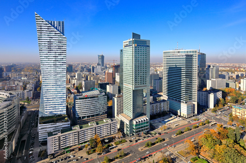 Obraz Panoramic aerial view of the skyscrapers - Zlota 44, Intercontinental and Warsaw Financial Center at the Emilii Plater street - in the Srodmiescie downtown district of Warsaw, Poland - fototapety do salonu