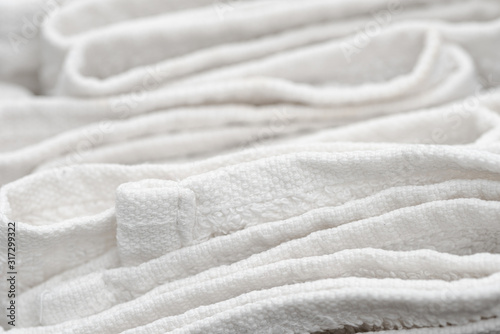 Valokuva Close up of sloppily folded white bathroom towels