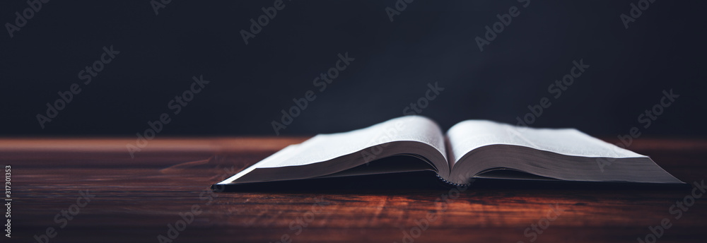 Fototapeta open book on wooden desk background