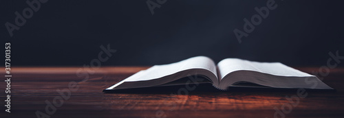 Photo open book on wooden desk background