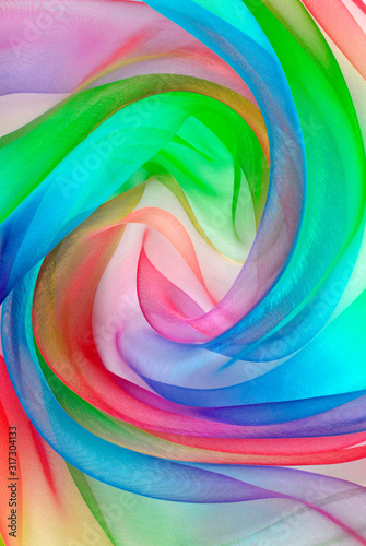 Fototapeta twisted twirl of organza fabric multicolour texture