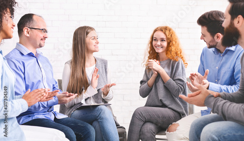 Woman appreciating support of people at group therapy meeting in rehab Canvas Print