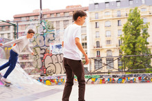 Teenage Boys Skateboarding At ...