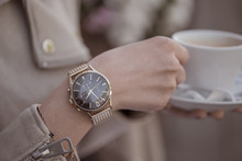 Elagant Watch On Woman Hand. Holding Coffee Cup.