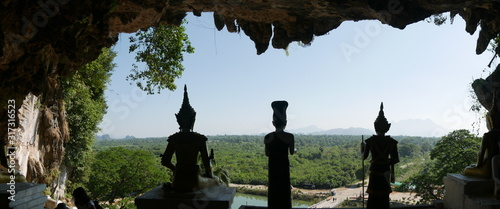 different statues of buddha at the entrance of a beautiful cave, Hpa An, Myanmar Fototapete
