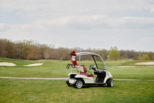 Golf Cart On Golf Course, Copy Space. Just Married Sign On Red Heart On Empty Golf Car Outdoors. Wedding Concept. Golf Club