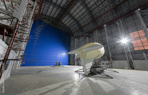 Photo Aerostat on a mobile mooring platform inside an giant airship hangar with huge b