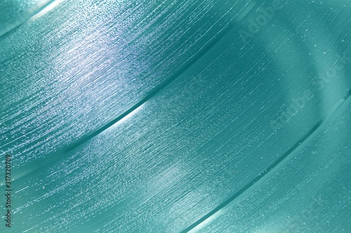 Photo Aquamarine shiny abstract vinyl record background texture with shades of blue ic
