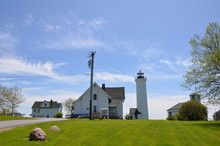 Tall White Lighthouse Building...