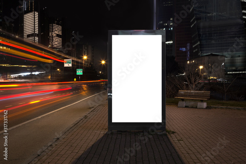 Obraz Blank billboard in night traffic - fototapety do salonu