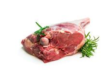 Fresh Raw Lamb Leg With Rosemary Leaves Isolated On White