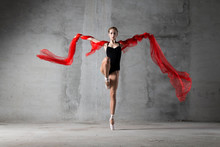 Girl On Pointe With A Red Clot...