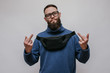 Handsome hipster guy with beard wearing blue blank sweatshirt with waist bag. Mockup for print
