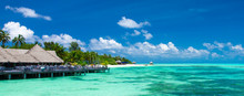 Beach With White Sand, Turquoise Ocean Water And Blue Sky With Clouds In Sunny Day. Natural Background For Summer Vacation. Panoramic View.