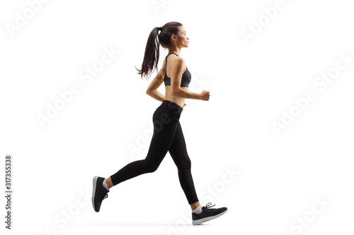 Foto Young woman jogging
