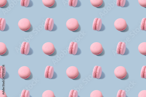 Photographie Sweet colorful macarons isolated on blue