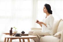 Mature Woman Drinking Tea In L...