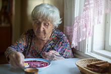 An Old Elderly Woman Eating So...