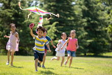 Happy Children Running With A ...