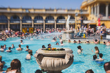 Budapest Spa Szechenyi Thermal Bath Spa Swimming Pool With Blue Sky In Summer Day With A Crowd Of People