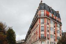 From Below Of Colorful Building In Paris, France On Cloudy Day