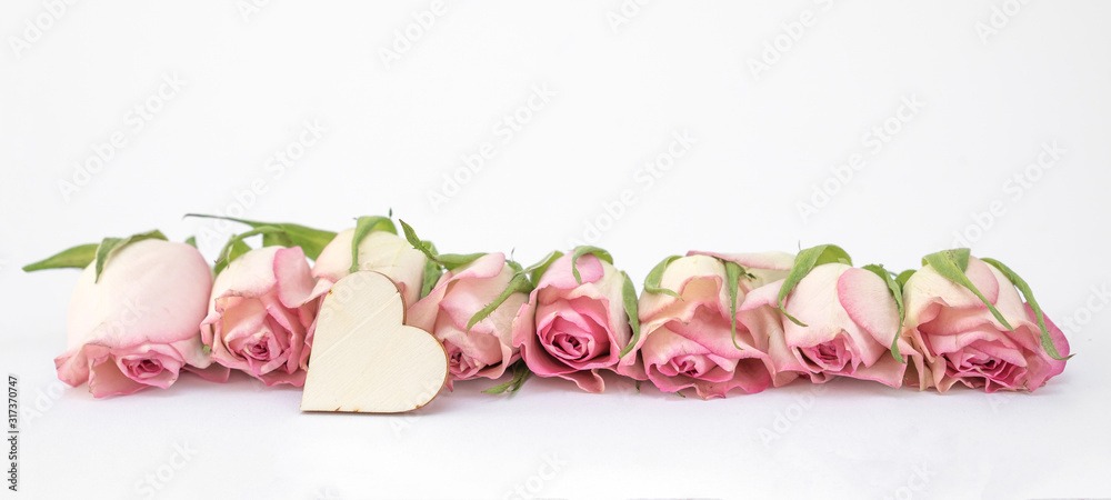 Fototapeta Pink roses and wooden heart isolated on white background texture vintage