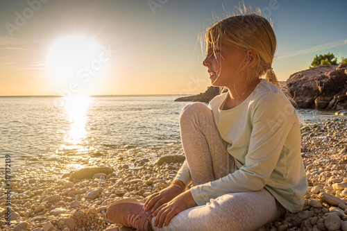 Croatia, Istria, Pula, Cape Kamenjak, blonde girl, sunset scene Canvas Print