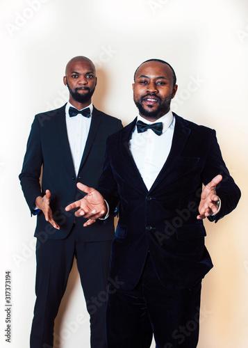 two afro-american businessmen in black suits emotional posing, gesturing, smiling Wallpaper Mural