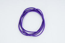 Purple Elastic Bands On A Whit...