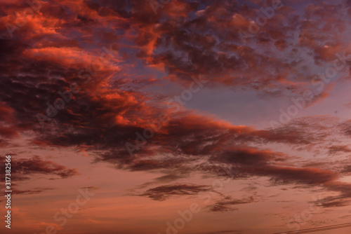 Magnificent altostratus cloud in magenta colors at sunset. Wallpaper Mural