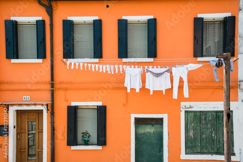 Facade of colorful house with laundry line