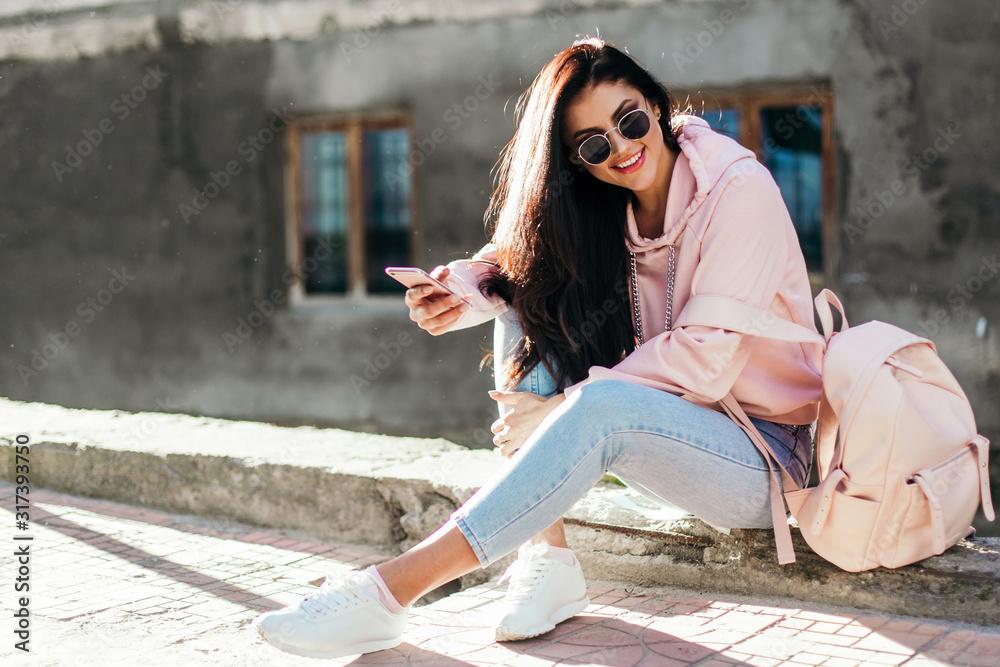 Fototapeta Beautiful model posing for the camera on the streets.