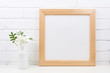 Wooden square frame mockup with Tobacco flowers