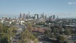Beautiful Aerial Drone View of Downtown Los Angeles and Echo Park Flying Away from Freeway 101 with Cars Passing During Rush Hour in a Clear Afternoon Day 4K with Beautiful Palm Trees and Skyline
