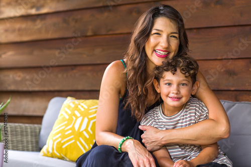 Portrait of a young Hispanic Mother and her son. Wallpaper Mural