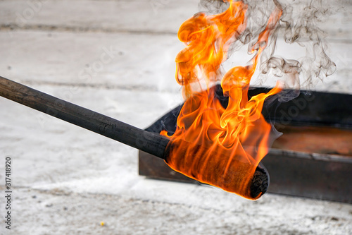 flaming torch impregnated with a mixture of oranges Canvas Print