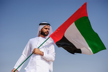 Proud Arabian Emirati Man Hold...