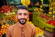 Arabian Man Offering A Pineapple On The Street In Goa