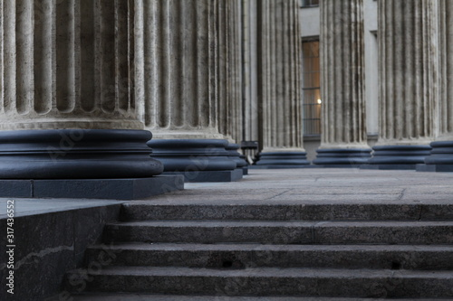 Stairs to the colonnade, classical Corinthian column older close up Fototapeta