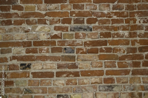 Closeup of a red stone wall - a nice picture for wallpapers and backgrounds