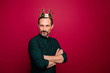 canvas print picture - Turned photo of arrogant man looking at you with hands folded and crown on head isolated vivid color background