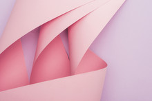 Top View Of Pink Paper Swirls On Violet Background