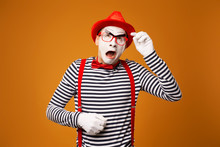 Young Surprised Mime In Red Ha...