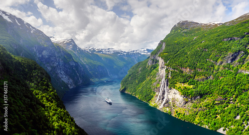 Panorama of breathtaking view of Sunnylvsfjorden fjord and famous Seven Sisters waterfalls, near Geiranger village in western Norway Canvas Print