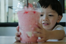 Happy Cute Boy Drink Strawberr...